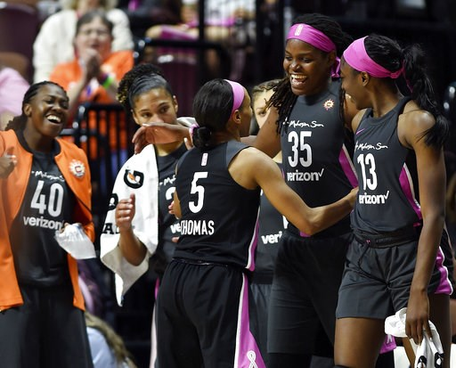 (Sean D. Elliot/The Day via AP). Connecticut Sun guard Jasmine Thomas (5) is greeted by teammates, from left to right, Shekinna Stricklen, Alyssa Thomas, Jonquel Jones and Chiney Ogwumike as she comes out of a WNBA basketball game against the Las Vegas...
