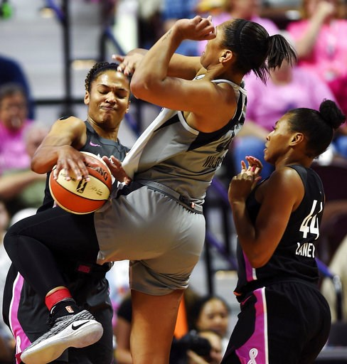 (Sean D. Elliot/The Day via AP). Connecticut Sun forward Alyssa Thomas, left, strips the ball from Las Vegas Aces forward A'ja Wilson as Sun's Betnijah Laney (44) helps on defense in the second half of WNBA basketball game action Sunday, Aug. 5, 2018, ...
