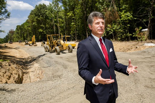 (AP Photo/Karen E. Segrave). In this July 25, 2018, photo, Stephen Bell, president and CEO of the Arkadelphia Area Chamber of Commerce, talks about a new railroad spur that is being built to support the needs of what he hopes will be a new paper mill, ...