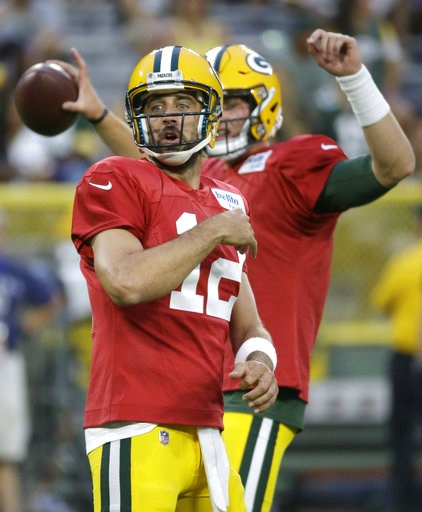 (AP Photo/Mike Roemer). Green Bay Packers quarterback Aaron Rodgers reacts to one of his passes during a quarterbacks drill during the NFL football team's Family Night practice Saturday, Aug. 4, 2018, in Green Bay, Wis.