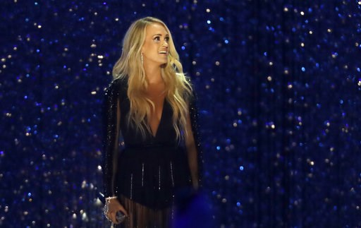 "(AP Photo/Mark Humphrey, File). FILE - In this June 6, 2018 file photo, Carrie Underwood performs "" Cry Pretty"" at the CMT Music Awards at the Bridgestone Arena in Nashville, Tenn. Underwood says her family is adding ""another fish to our pond.""  The 35..."