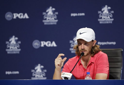 (AP Photo/Darron Cummings). Tommy Fleetwood, of England, responds to a question during a news conference at the PGA Championship golf tournament at Bellerive Country Club, Wednesday, Aug. 8, 2018, in St. Louis.