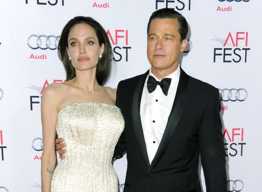 "(Photo by Richard Shotwell/Invision/AP, File). FILE - In this Nov. 5, 2015 file photo, Angelina Jolie, left, and Brad Pitt arrive at the 2015 AFI Fest opening night premiere of ""By The Sea"" in Los Angeles. Jolie Pitt says she wants her divorce from Bra..."
