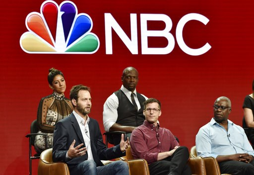 "(Photo by Chris Pizzello/Invision/AP). Dan Goor, bottom left, executive producer of the NBC Universal television series ""Brooklyn Nine-Nine,"" answers a question as cast members, from left, Stephanie Beatriz, Terry Crews, Andy Samberg and Andre Braugher..."