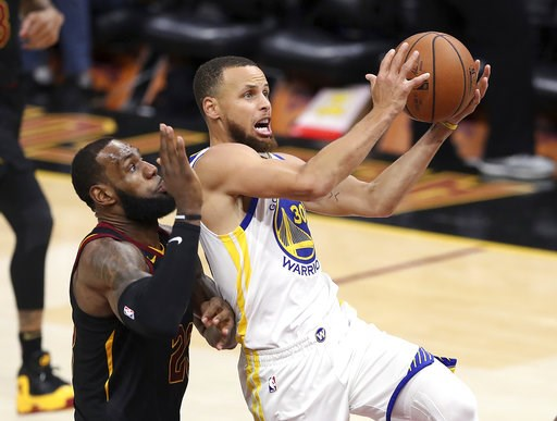 (AP Photo/Carlos Osorio, File). FILE - In this June 6, 2018 file photo, Golden State Warriors' Stephen Curry goes to the basket against Cleveland Cavaliers' LeBron James, left, during the second half of Game 3 of basketball's NBA Finals in Cleveland. C...