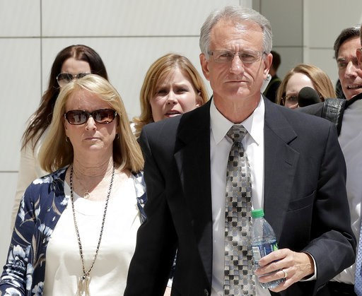 (AP Photo/Matt York, File). FILE - In this June 7, 2017, file photo,  former Arizona Corporation Commissioner Gary Pierce, and his wife Sherry, left, leave court in Phoenix after being arraigned on bribery and fraud charges. Prosecutors said Tuesday, A...