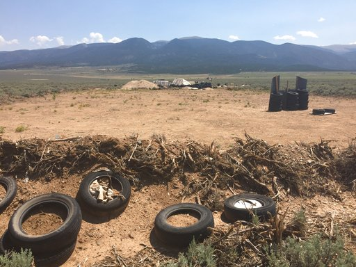 (AP Photo/Morgan Lee). CORRECTS BYLINE TO MORGAN LEE INSTEAD OF LEE MORGAN - A makeshift shooting range stands adjacent to a disheveled living compound in Amalia, N.M., on Tuesday, Aug. 7, 2018. A New Mexico sheriff said searchers have found the remain...