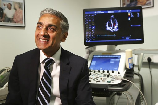 (AP Photo/Robert Stevens). Dr. Sanjay Sharma, professor of cardiology at St. George's University of London, speaks during an interview on Wednesday Aug. 8, 2018 about a study he led which found procedures that can help identify athletes who are at risk...