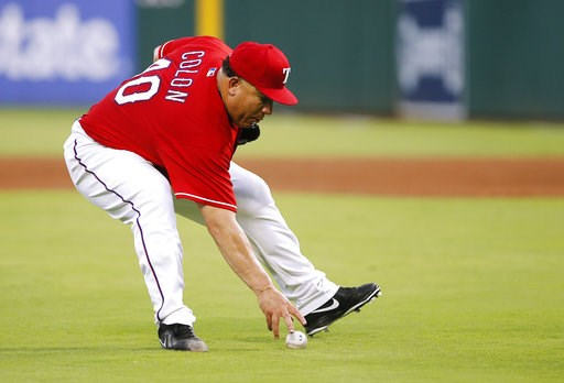 (AP Photo/Brandon Wade). Texas Rangers starting pitcher Bartolo Colon fields a soft infield hit by Seattle Mariners' Cameron Maybin during the fourth inning of a baseball game, Tuesday, Aug. 7, 2018, in Arlington, Texas. Colon threw to first for the ou...