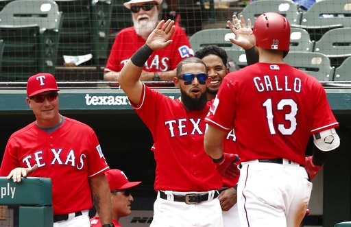 (AP Photo/Mike Stone). From left, Texas Rangers manager Jeff Banister, Rougned Odor and Elvis Andrus congratulate Joey Gallo (13) after his second home run against the Seattle Mariners during the fifth inning of a baseball game Wednesday, Aug. 8, 2018,...