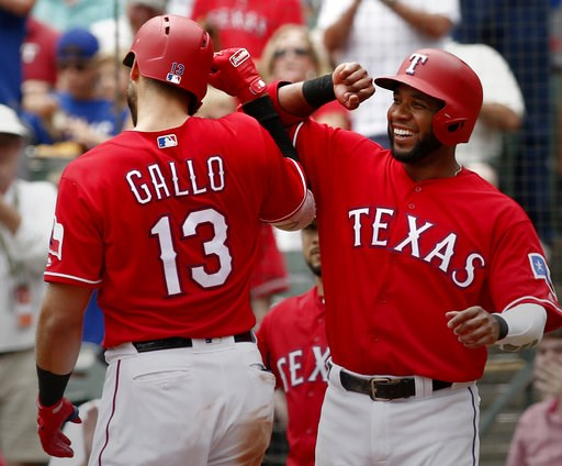 (AP Photo/Mike Stone). Texas Rangers Joey Gallo (13) is congratulated by Elvis Andrus after he hit a home run against the Seattle Mariners during the third inning of a baseball game Wednesday, Aug. 8, 2018, in Arlington, Texas.