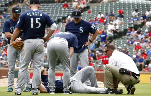 (AP Photo/Mike Stone). Seattle Mariners pitcher Mariners Sam Tuivailala receives assistance after getting injured against the Texas Rangers as third baseman Kyle Seager (15) manager Scott Servais (29) and pitching coach Mel Stottlemyre (30) look on dur...