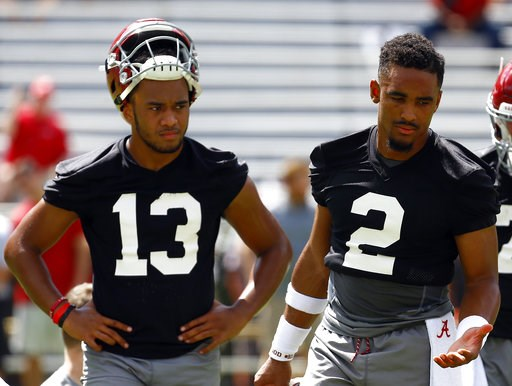 (AP Photo/Butch Dill). Alabama quarterback Jalen Hurts (2) and quarterback Tua Tagovailoa (13) runs drills during a NCAA college football practice, Saturday, Aug. 4, 2018, in Tuscaloosa, Ala.