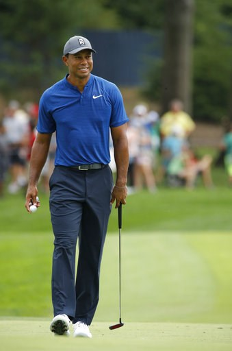 (AP Photo/Charlie Riedel). Tiger Woods walks on the 12th green during a practice round for the PGA Championship golf tournament at Bellerive Country Club, Wednesday, Aug. 8, 2018, in St. Louis.