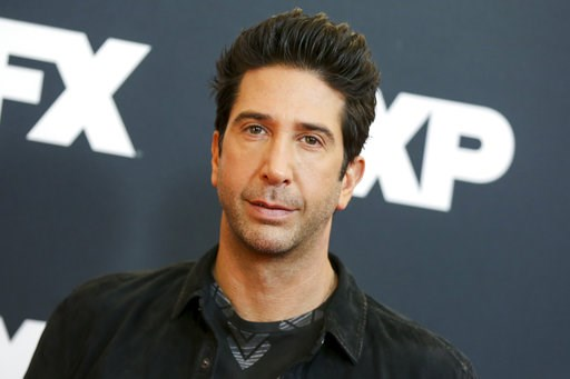 """(Photo by Rich Fury/Invision/AP, File). FILE - In this Jan. 16, 2016 file photo, David Schwimmer arrives at the 2016 FX Winter TCA in Pasadena, Calif. NBC announced that Schwimmer will have a recurring role on """"Will & Grace"""" as Grace's new love int..."""