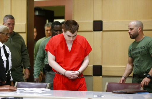 (AP Photo/Wilfredo Lee, Pool, File). FILE - In this Friday, Aug. 3, 2018 file photo, school shooting suspect Nikolas Cruz arrives at a Broward County courtroom for a hearing in Fort Lauderdale, Fla. A newly released transcript shows Florida school shoo...