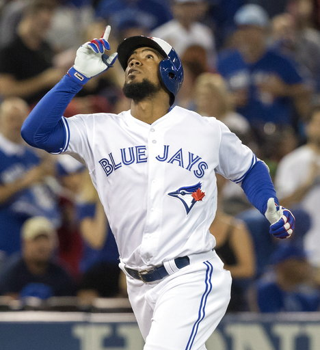 (Fred Thornhill/The Canadian Press via AP). Toronto Blue Jays' Teoscar Hernandez crosses home plate after hitting a two-run home run against the Boston Red Sox during the sixth inning of a baseball game Wednesday, Aug. 8, 2018, in Toronto.