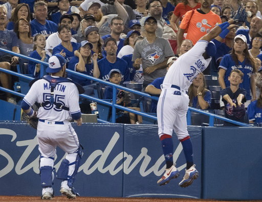(Fred Thornhill/The Canadian Press via AP). Toronto Blue Jays' Yangervis Solarte just misses catching a foul ball off the bat of Boston Red Sox's Rafael Devers during the seventh inning of a baseball game Wednesday, Aug. 8, 2018, in Toronto.