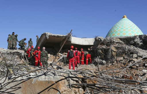 (AP Photo/Tatan Syuflana). Rescuer teams continue to search for victims in the collapsed Jamiul Jamaah Mosque in Bangsal, North Lombok, Indonesia, Wednesday, Aug. 8, 2018. The north of Lombok was devastated by the powerful earthquake that struck Sunday...
