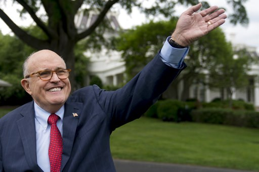 (AP Photo/Andrew Harnik, File). FILE - In this May 29, 2018, file photo, Rudy Giuliani, an attorney for President Donald Trump, waves to people during White House Sports and Fitness Day on the South Lawn of the White House in Washington. Giuliani, says...