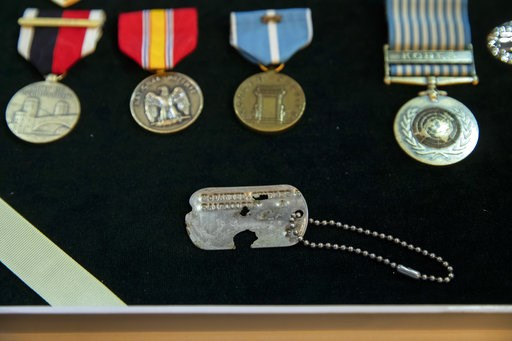 (AP Photo/J. Scott Applewhite). A dog tag from Master Sgt. Charles Hobert McDaniel, who died in the Korean War in 1950 and was among recently repatriated remains from North Korea, is displayed with his service medals during a ceremony by military offic...