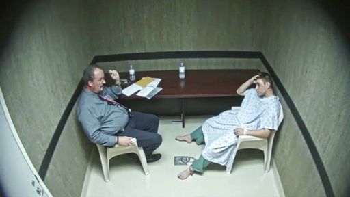 (Broward County Sheriff's Office via AP). In this image made from video provided on Wednesday, Aug. 8, 2018, by the Broward County Sheriff's Office, Detective John Curcio, left, talks to Nikolas Cruz at an interrogation room in Fort Lauderdale, Fla. Pr...