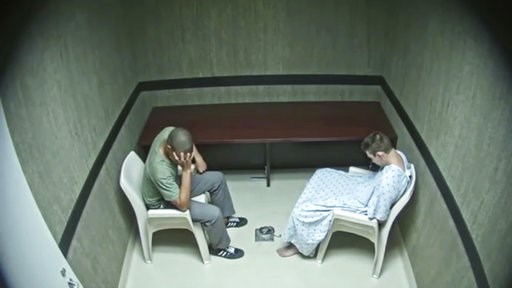(Broward County Sheriff's Office via AP). In this image made from video provided on Wednesday, Aug. 8, 2018, by the Broward County Sheriff's Office, Zachary Cruz, left, reacts as he was speaking with his brother Nikolas Cruz at an interrogation room in...