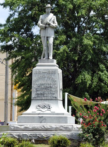 (AP Photo/Jay Reeves). A Confederate monument dedicated in 1909 stands in the middle of the square in Tuskegee, Ala., on Thursday, June 28, 2018. Demonstrators once tried to topple the monument and it has been the target of vandals. Yet a Confederate h...