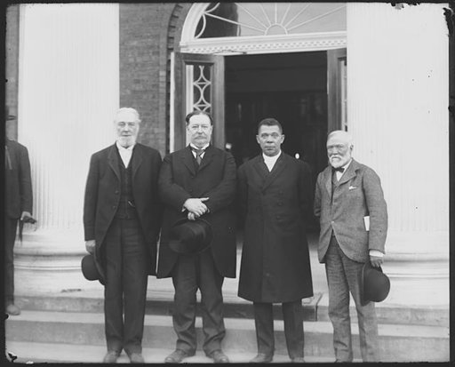 (Frances Benjamin Johnston/Library of Congress via AP). Robert C. Ogden, William Howard Taft, Booker T. Washington and Andrew Carnegie, left to right, stand on the steps of a building in April 1906 during the 25h anniversary celebration of what is now ...