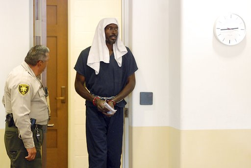 (AP Photo/Morgan Lee). Lucas Morton arrives in court to plead not guilty to child abuse charges in state district court in Taos, N.M., Wednesday, Aug. 8, 2018. Morton was arrested Friday in a raid on a disheveled living compound where authorities say t...