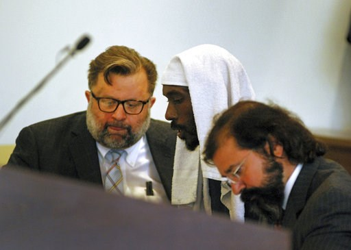 (AP Photo/Morgan Lee). Lucas Morton, center, pleads not guilty to child abuse charges in state district court in Taos, N.M., Wednesday, Aug. 8, 2018. Morton is accompanied by public defense attorneys, Greg Dawkins, left, and Aleks Kostich, right. Morto...