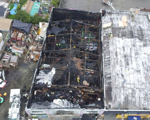 (City of Oakland via AP, File). FILE - This undated file photo provided by the City of Oakland shows inside the burned warehouse after the deadly fire that broke out on Dec. 2, 2016, in Oakland, Calif. Two men who pleaded no contest to 36 charges of in...
