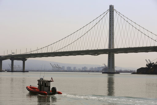(AP Photo/Lorin Eleni Gill). A dull haze fills the air around the San Francisco Bay Bridge and Oakland, Calif., Wednesday, Aug. 8, 2018. Blazes in Northern California and near Yosemite National Park have caused air quality to worsen in cities miles awa...
