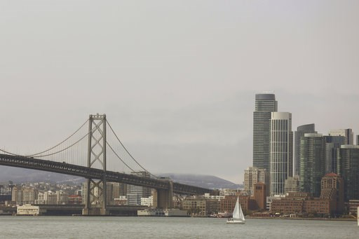 (AP Photo/Lorin Eleni Gill). A haze of smoke blankets San Francisco Wednesday, Aug. 8, 2018. Public health and air quality experts say the smoke drifting over cities in California is lasting for a longer stretch than normal as some of the biggest wildf...