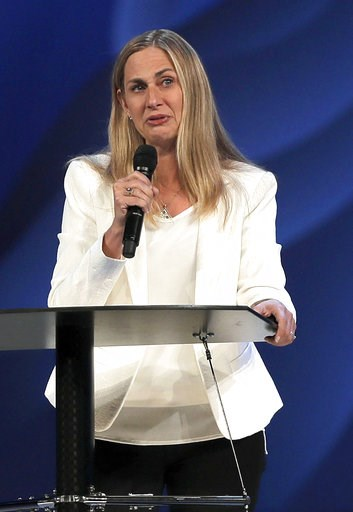 (Steve Lundy/Daily Herald via AP). Willow Creek Community Church lead pastor Heather Larson speaks at the church, Wednesday, Aug. 8, 2018, in South Barrington, Ill. Larson said she is stepping down, and the entire Board of Elders will do so by the end ...