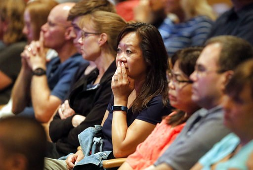 (Steve Lundy/Daily Herald via AP). Audience members react as it was announced, Wednesday, Aug. 8, 2018, at Willow Creek Community Church in South Barrington, Ill., that lead pastor Heather Larson is stepping down, and the entire Board of Elders will do...