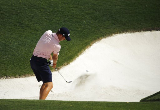(AP Photo/Charlie Riedel). Justin Thomas hits out of a bunker on the 15th hole during a practice round for the PGA Championship golf tournament at Bellerive Country Club, Wednesday, Aug. 8, 2018, in St. Louis.