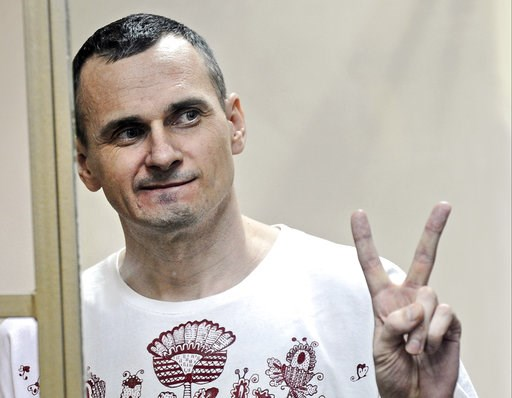 (AP Photo, file). FILE - In this Tuesday, Aug. 25, 2015 file photo, Oleg Sentsov gestures as the verdict is delivered, as he stands behind bars at a court in Rostov-on-Don, Russia. The lawyer for a hunger-striking Ukrainian filmmaker imprisoned in Russ...