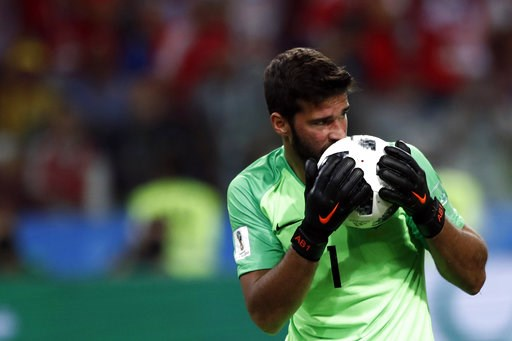 (AP Photo/Matthias Schrader, file). FILE - In this Wednesday, June 27, 2018 file photo, Brazil goalkeeper Alisson kisses the ball after making a save during their match against Serbia, at the 2018 soccer World Cup in the Spartak Stadium in Moscow, Russ...