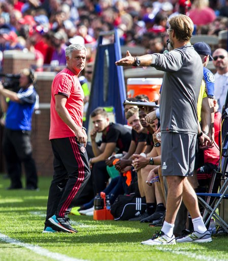 (AP Photo/Tony Ding). Manchester United manager Jose Mourinho, left, has an exchange on the touchline with Liverpool manager Jurgen Klopp, right, during the first half of an International Champions Cup tournament soccer match at Michigan Stadium, Satur...