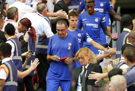 (AP Photo/Tim Ireland). Chelsea's manager Maurizio Sarri walks after Chelsea collected their second place medals after they lost the Community Shield soccer match between Chelsea and Manchester City at Wembley, London, Sunday, Aug. 5, 2018.