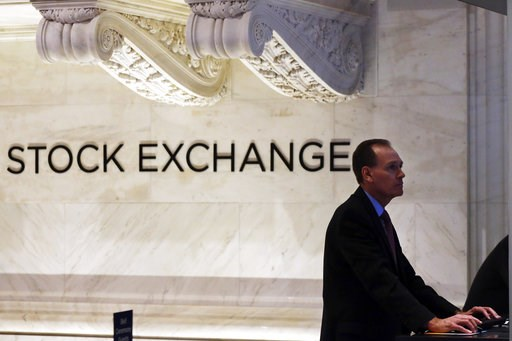 (AP Photo/Mark Lennihan, File). FILE- In this Jan. 2, 2018, file photo, a trader works at the New York Stock Exchange. The U.S. stock market opens at 9:30 a.m. EDT on Thursday, Aug 9.