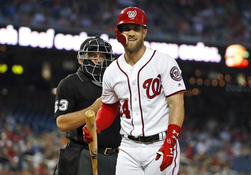 (AP Photo/Alex Brandon). Washington Nationals' Bryce Harper laughs at a called third strike by home plate umpire Greg Gibson during the third inning of the team's baseball game against the Atlanta Braves at Nationals Park, Wednesday, Aug. 8, 2018, in W...