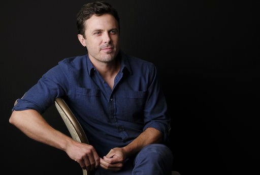 "(Photo by Chris Pizzello/Invision/AP). In this Aug. 3, 2018 photo, actor Casey Affleck poses for a portrait at the Four Seasons Hotel in Los Angeles to promote his upcoming film ""The Old Man & The Gun,"" in theaters on Sept. 28."