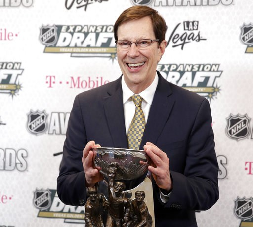 (AP Photo/John Locher, File). FILE - In this June 21, 2017, file photo, David Poile, general manager of the Nashville Predators, poses with the NHL General Manager of the Year Award after winning the honor at the NHL Awards in Las Vegas. Poile headline...