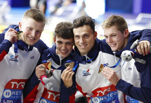 (AP Photo/Darko Bandic). From left, Adam Peaty, Nicholas Pyle, James Guy, Duncan W Scott, of Great Britain, pose with their gold medals won 4 X 100 meters medley relay men final at the European Swimming Championships in Glasgow, Scotland, Thursday, Aug...