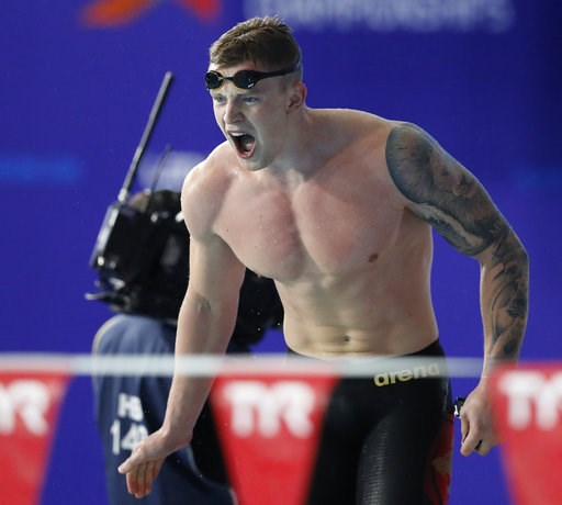 (AP Photo/Darko Bandic). Adam Peaty of Great Britain reacts during the 4 X 100 meters medley relay men final at the European Swimming Championships in Glasgow, Scotland, Thursday, Aug. 9, 2018.