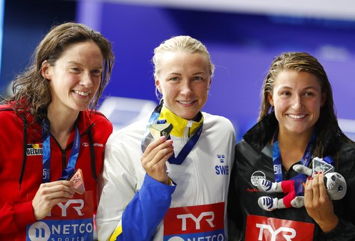(AP Photo/Darko Bandic). Silver medalist Emilie Beckmann of Denmark, right, gold medalist Sarah Sjoestroem of Sweden, bronze medalist Kimberly Buys of Belgium pose on the podium of 50 meters butterfly women final at the European Swimming Championships ...