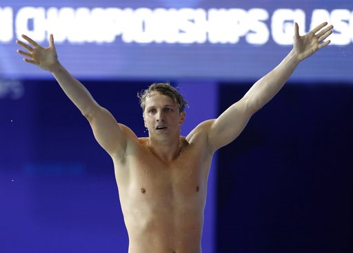 (AP Photo/Darko Bandic). David Verraszto of Hungary celebrates after finishing first the 400 meters individual medley men final at the European Swimming Championships in Glasgow, Scotland, Thursday, Aug. 9, 2018.