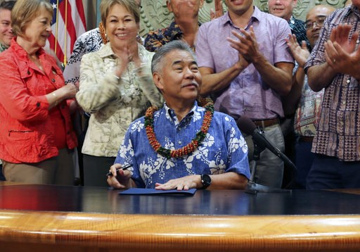 (AP Photo/Audrey McAvoy, File). FILE - In this June 13, 2018 file photo, Hawaii lawmakers applaud after Gov. David Ige, who is running for a second term in office, signed legislation in Honolulu. Ige faces a stiff challenge in the Democratic primary on...